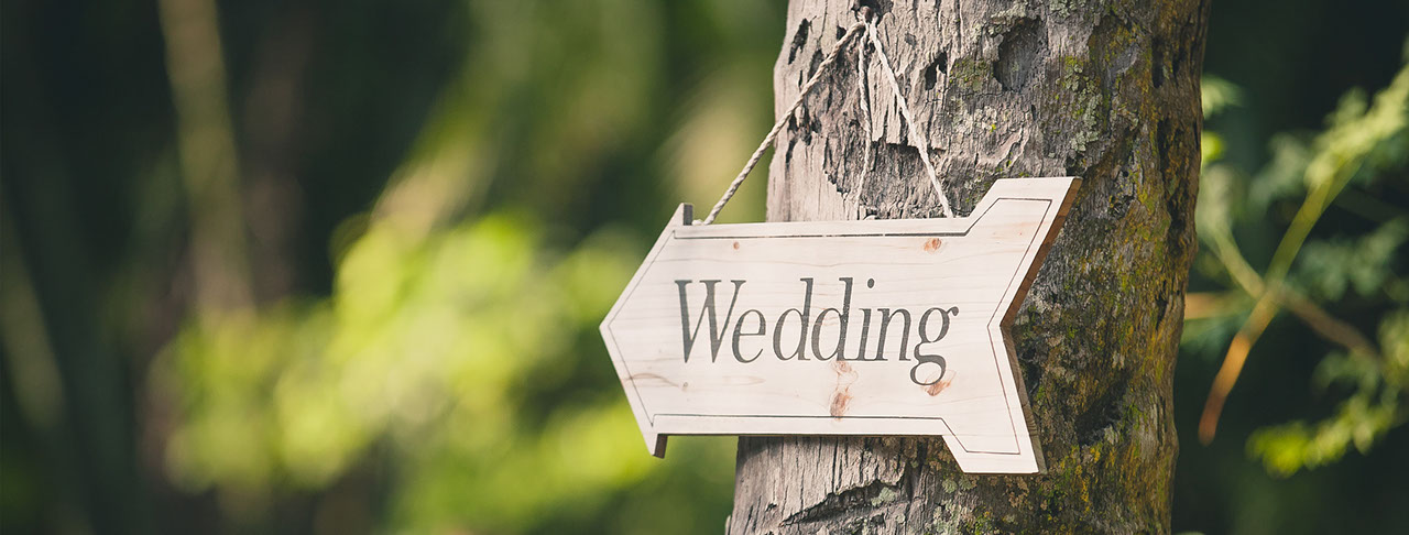 signage pointing to a wedding